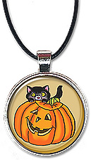 Halloween necklace or keychain features a cute black cat hiding in back of a jack-o-lantern.