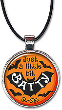 Halloween necklace or keychain with the message: Just a little bit batty.