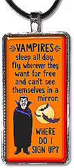 Handcrafter, lighthearted Halloween pendant or keychain with the message: Vampires sleep all day, fly wherever they want for free and can't see themselves in a mirror. Where do I sign up?