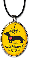 Handcrafted necklace or keychain with the message: I love my dachshund, with 75+ dog breeds available.