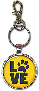 This keychain or necklace features the word love in capital letters with the 'O' replaced with a paw print.
