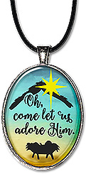 Christian Christmas necklace features the bright star over the baby Jesus with the message: oh come let us adore Him. It's also available as a keychain.