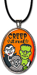 Frankenstein, Dracula & the Wolfman are featured on this handcrafted Halloween necklace or keychain with the message: Creep it real!