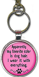This handcrafted keychain has the message: apparently my favorite color is dog hair. I wear it with everything. It's also available as a necklace.