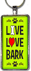 Handcrafted dog keychain has the message: LIVE, LOVE, BARK, and is available as a pendant or keyring.