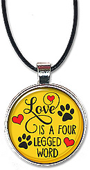 Handcrafted for dog and all animal lovers, this necklace or keychain features the quote: love is a four legged word..