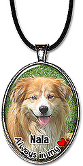 Sample of a custom photo pet memorial necklace, is also available as a keychain, and can be personalized with pet's name.