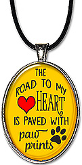 The Road To My Heart Is Paved With Paw Prints Necklace or Keychain would be an appreciate gift for any dog or animal lover.
