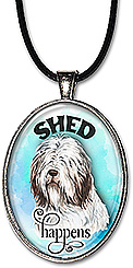 Original art watercolor hairy sheepdog with caption: SHED HAPPENS, is available as a necklace or keychain.